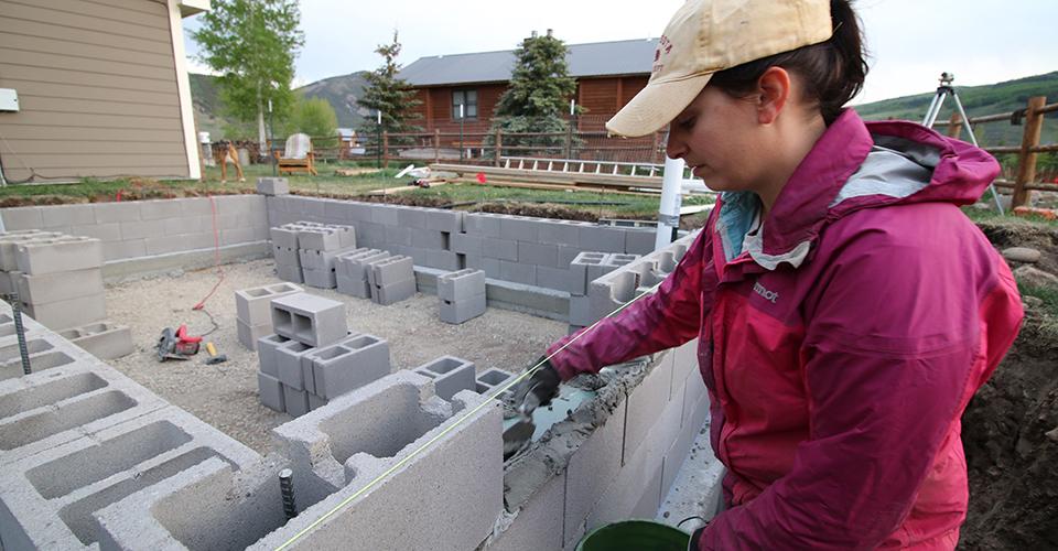 Kara Holzmiller Mortaring the Concrete Block Wall